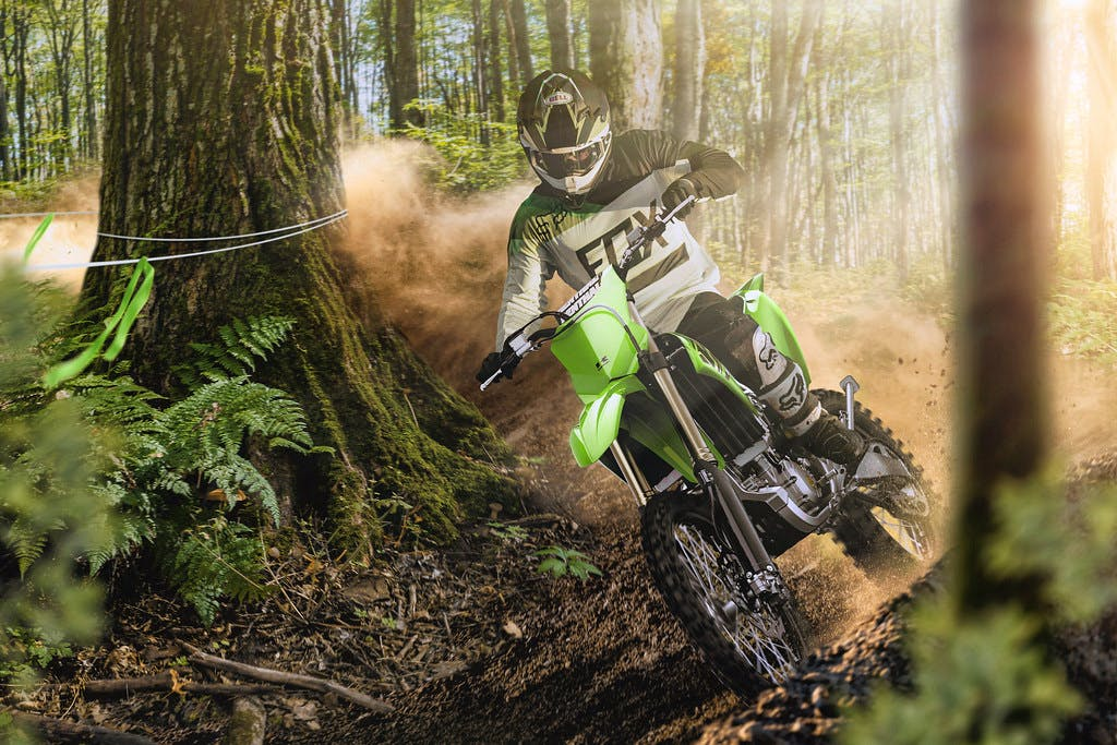 Kawasaki KX250X in Lime Green colour on off-road track