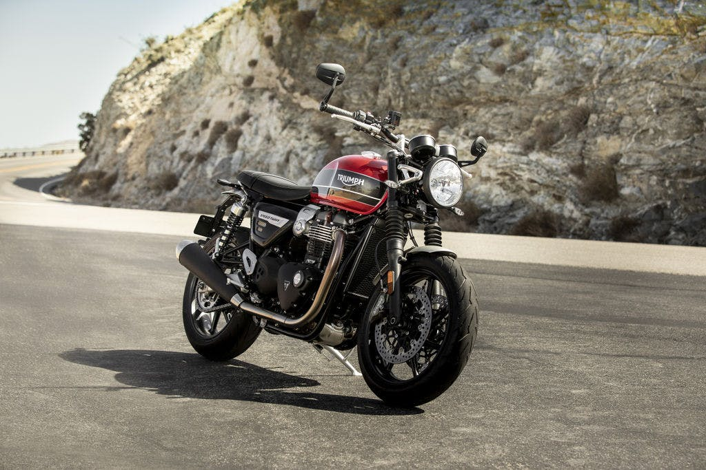 TRIUMPH BONNEVILLE SPEED TWIN in korosi red and storm grey colour, parked