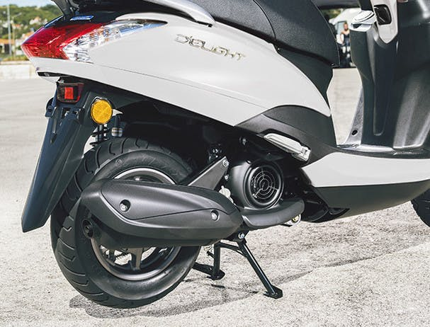 Yamaha D'elight 125 scooter on centre stand with exhaust