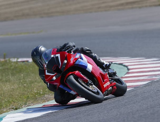 Honda CBR600RR in Grand Prix Red colour on race track