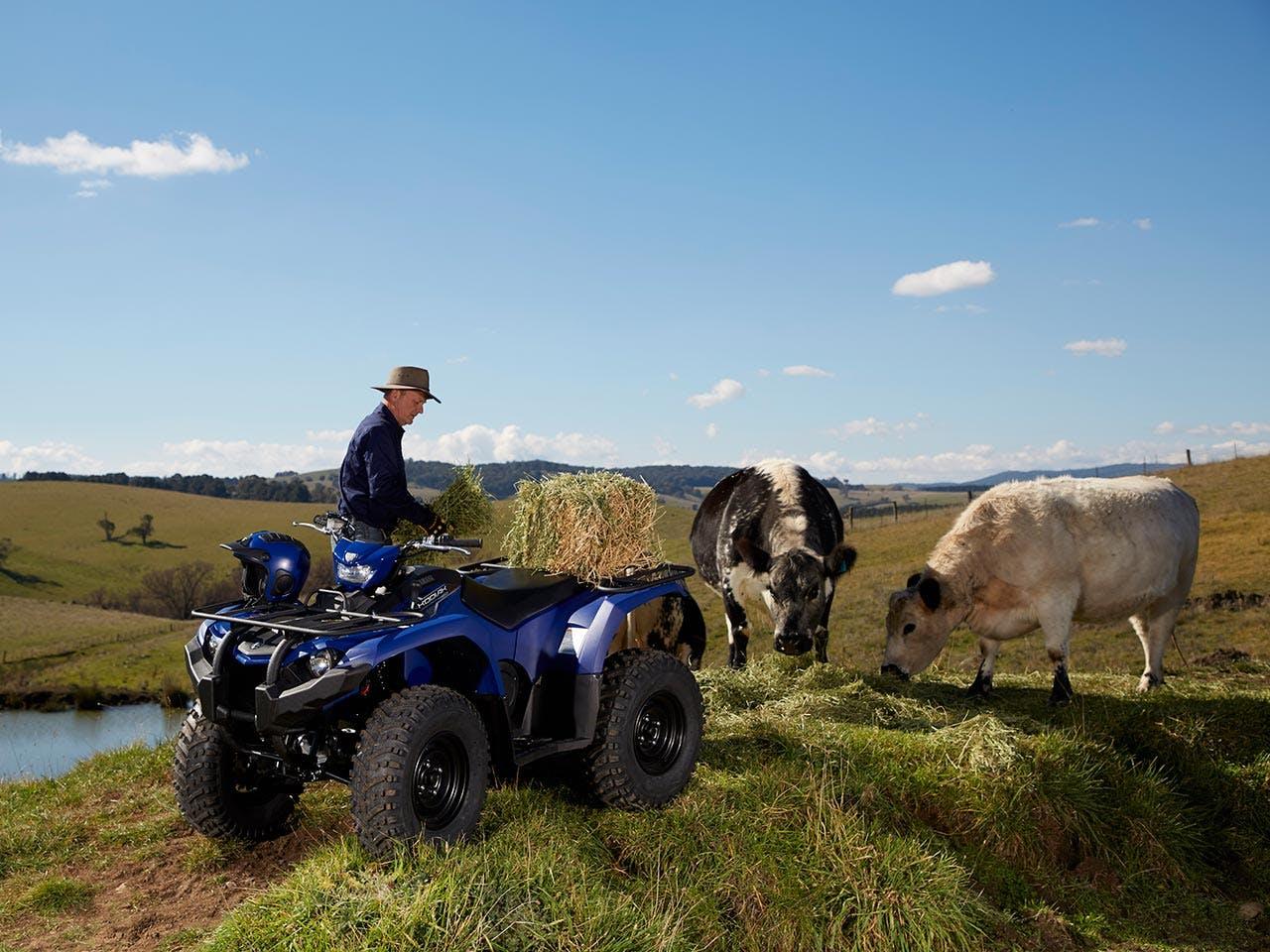 Yamaha Kodiak 450 EPS in steel blue colour towing hay bales
