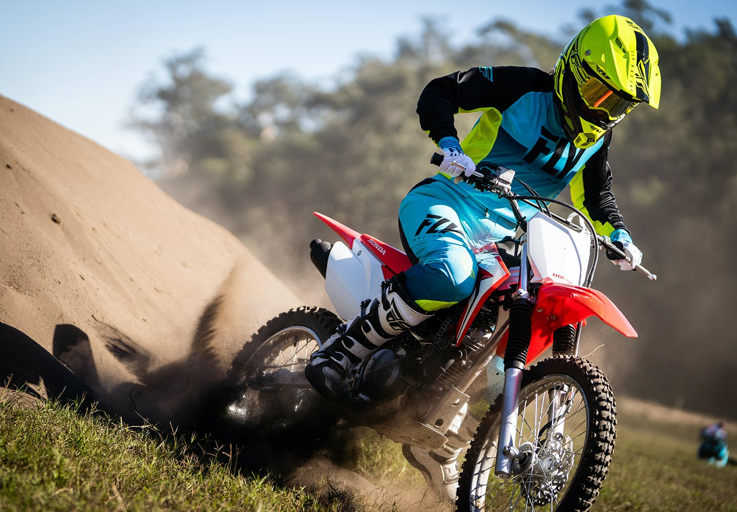 Honda CRF125F in extreme red colour on off road track