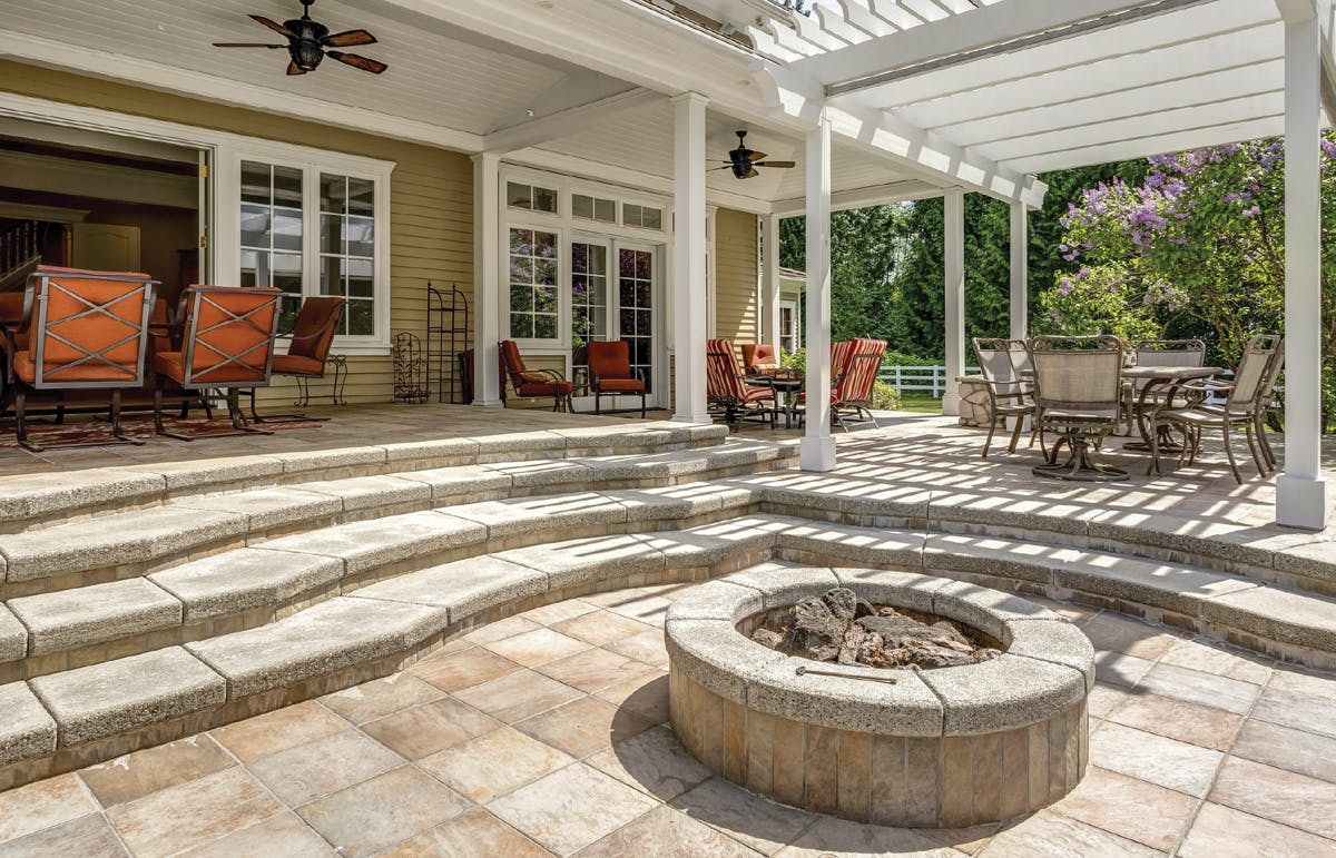 Stone patio with a fire pit