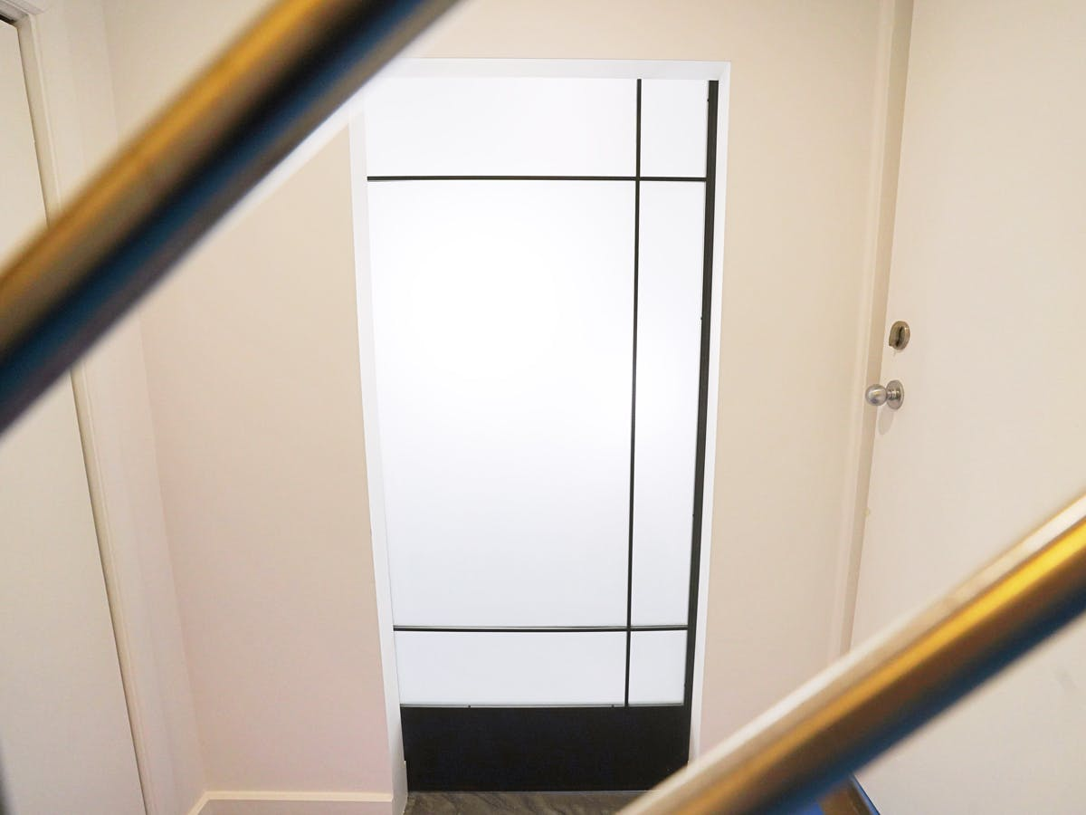 Office door seen from staircase