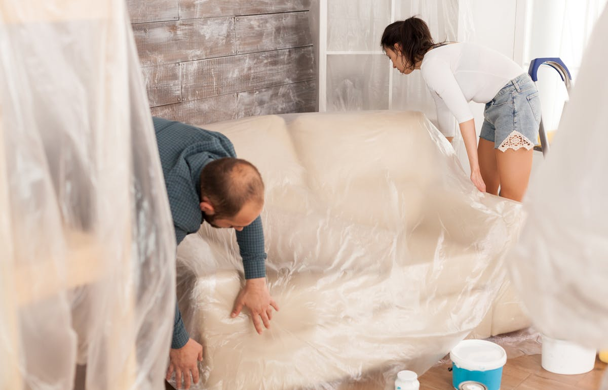 Couple covering a couch plastic