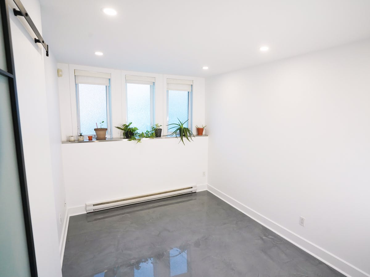 Renovated basement office with three windows