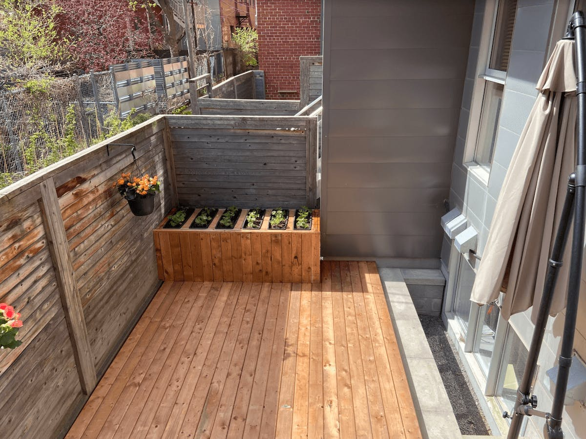 Renovated balcony with raised flower beds in Montreal
