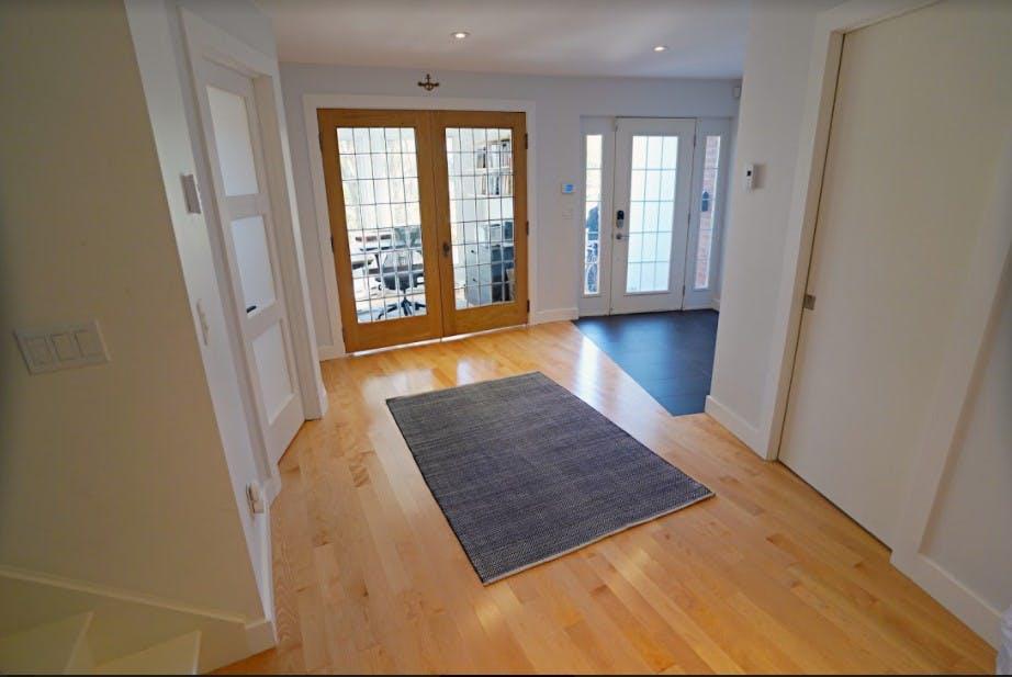 Hallway view of guest room, office and front door