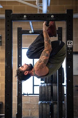 Sam Elias performs eggroll exercise