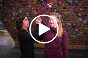 Thumbnail image for a video with Esther Smith and Claire Baurfeind in a climbing gym with a play button overlaid.