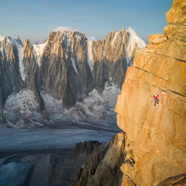 A photo by Jon Griffith of Hazel Findlay trad climbing