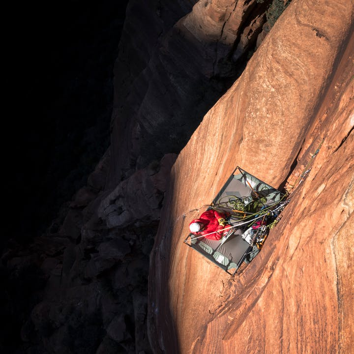 climber resting on a portaledge
