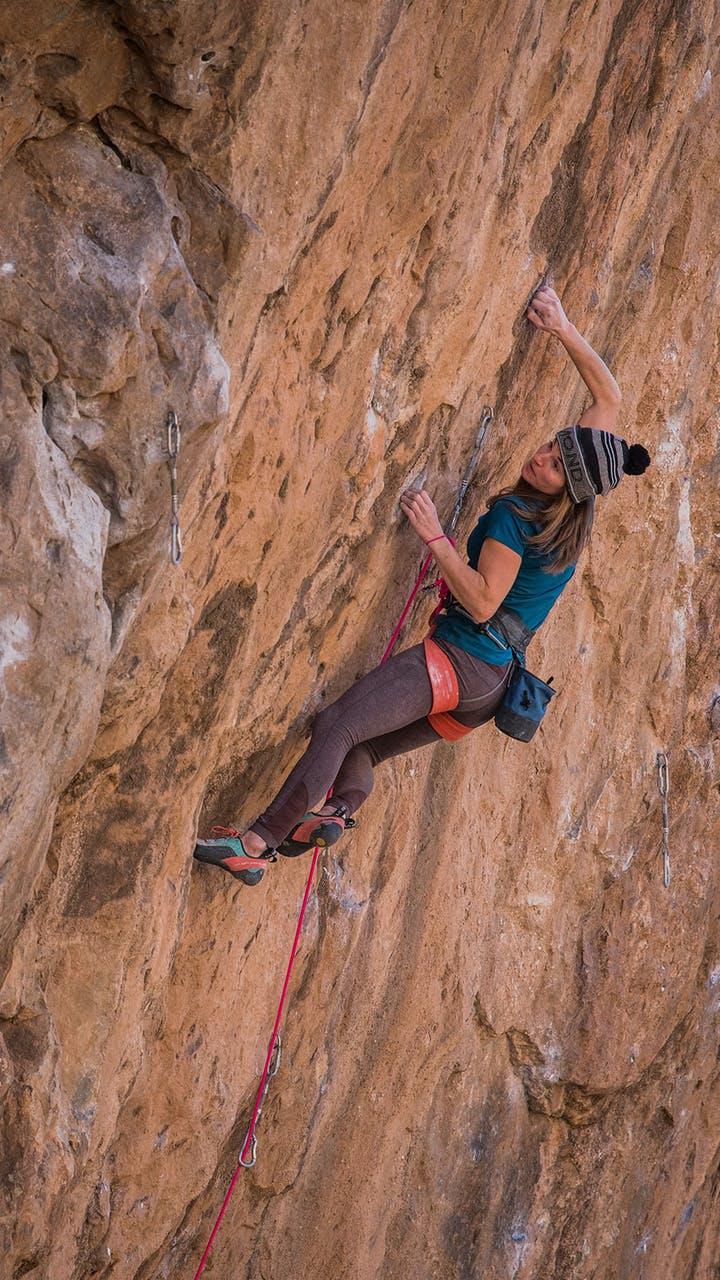 climber working up a route