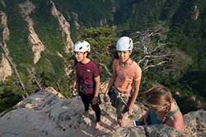 3 climbers gathered on a belay ledge