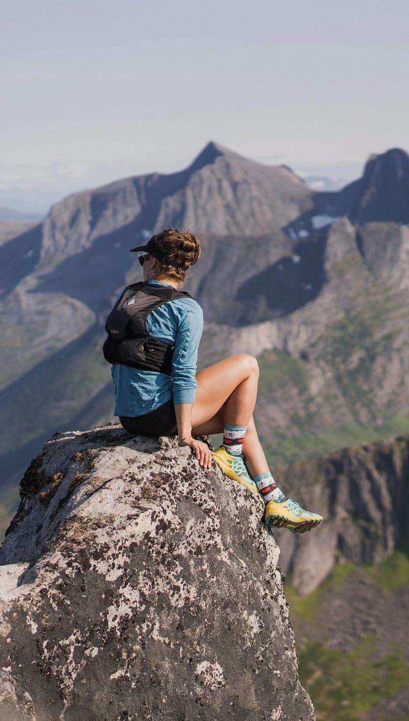 Hillary Gerardi wearing a Distance 4 hydration pack while enjoying a mountain vista