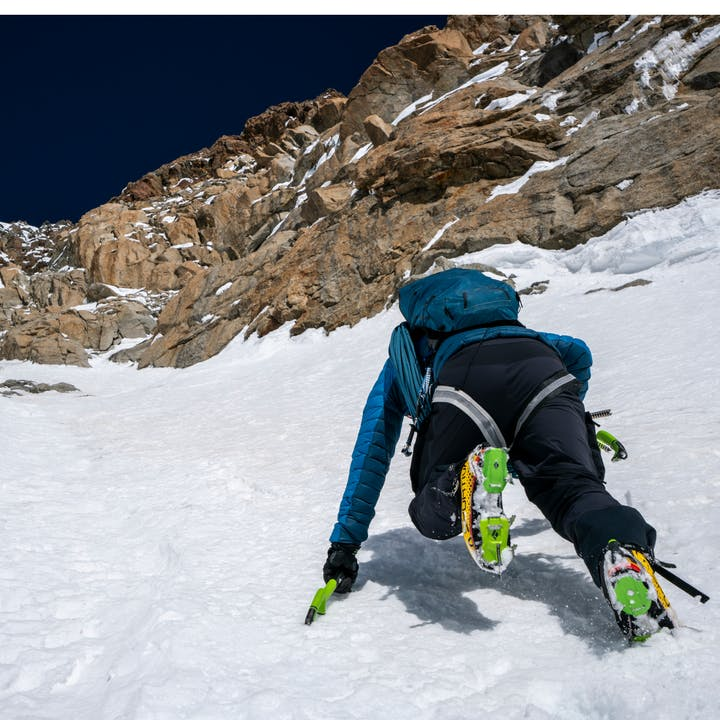 Alpine climber climbing in Black Diamond crampons   Ice climbing tools