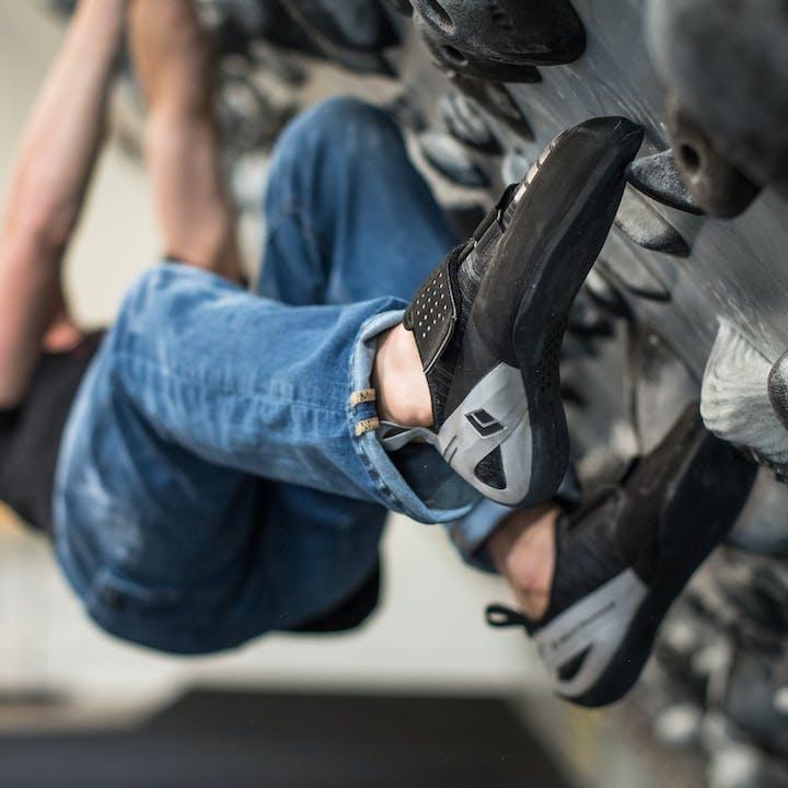 man bouldering inside | Black Diamond climbing shoes