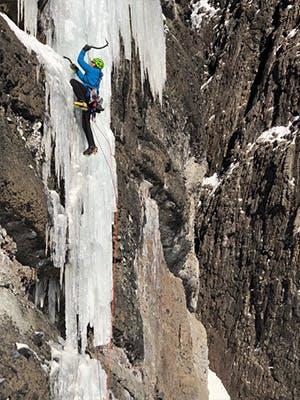 Photograph by Kolin Powick of Doug Chabot ice climbing in Montana