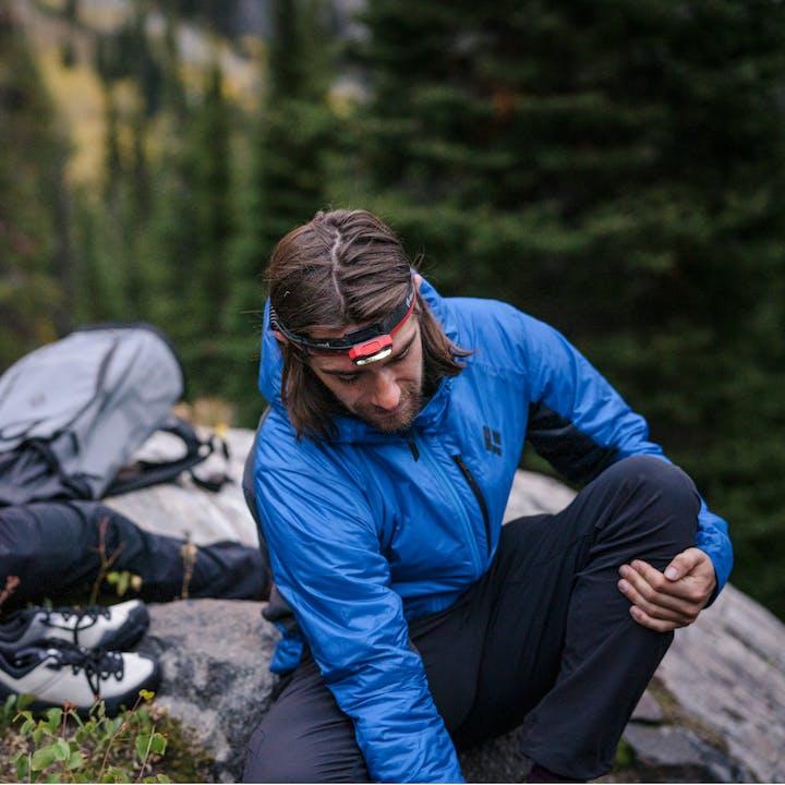 A hiker using the new Black Diamond Vision Down Hybrid Hoody.