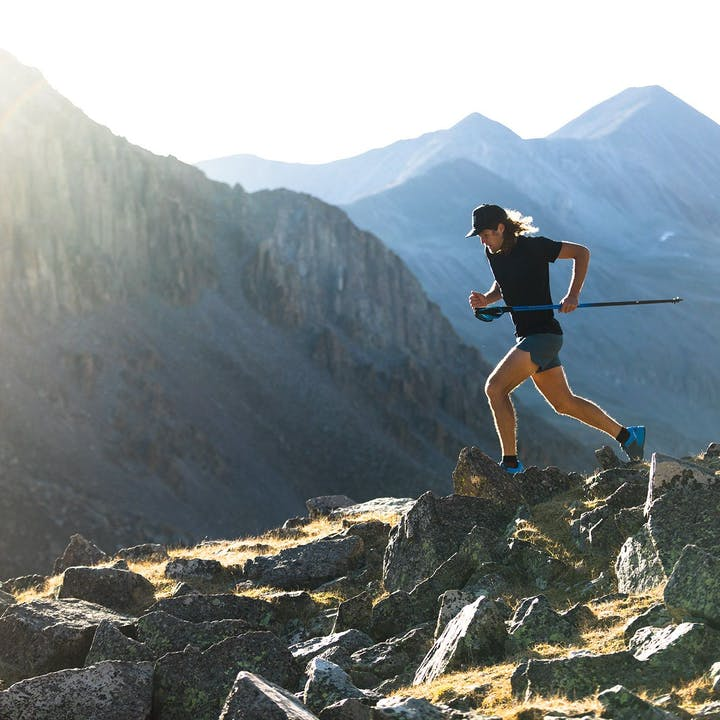 Photograph by Forest Woodward of Joe Grant running along a ridge