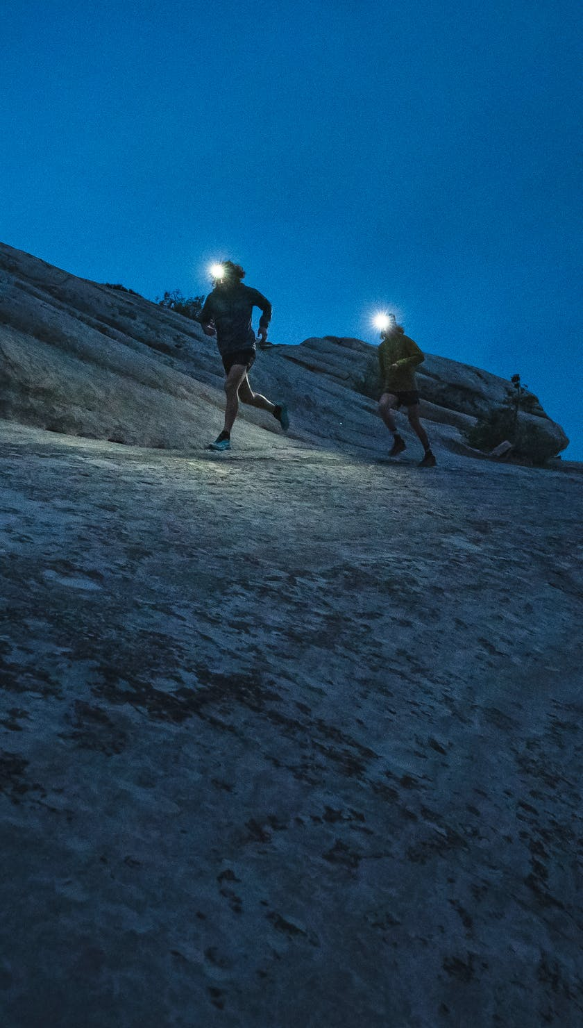 BD Athletes Joe Grant and Kyle Richardson running in the desert at night