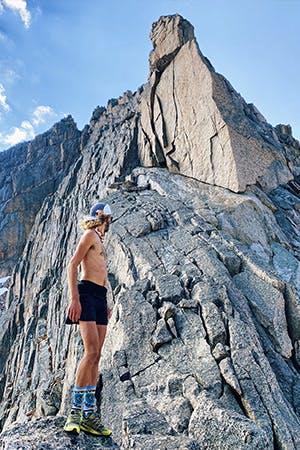 Kyle looking up at summit of Long Peak