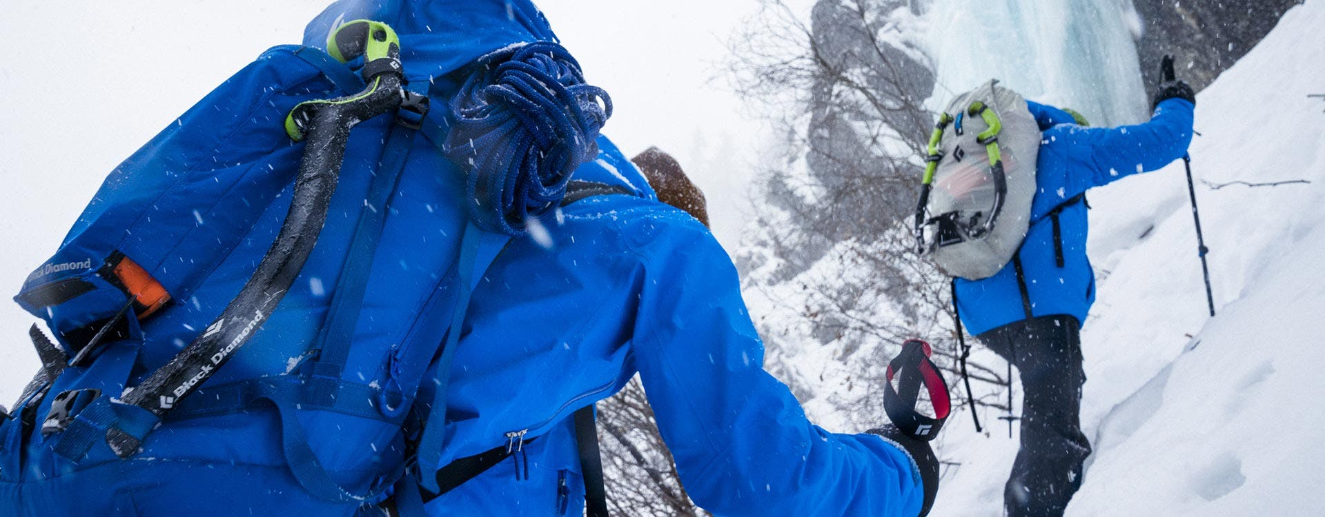 two ice climbers approaching a route