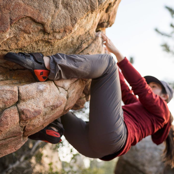 Photograph by Christian Adam of a woman bouldering outside