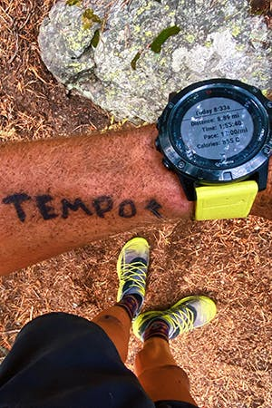 Kyle Richardson tempo writing on wrist for reminder.