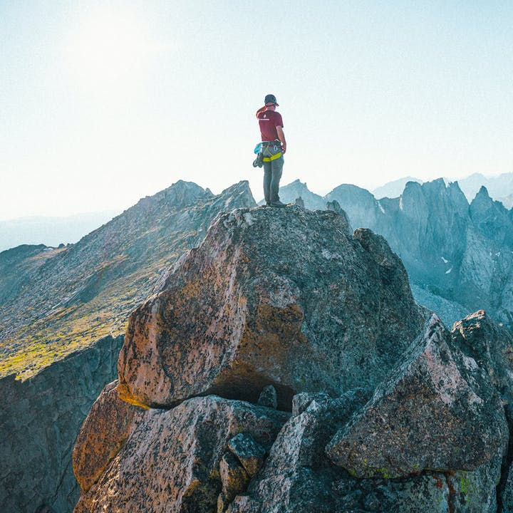 Climber standing on mountain peak