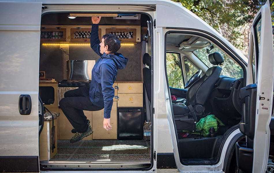 Alex Honnold hangboarding in his van