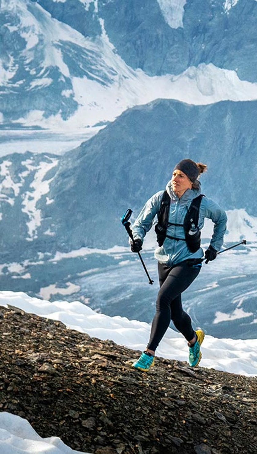 athlete running up a mountain