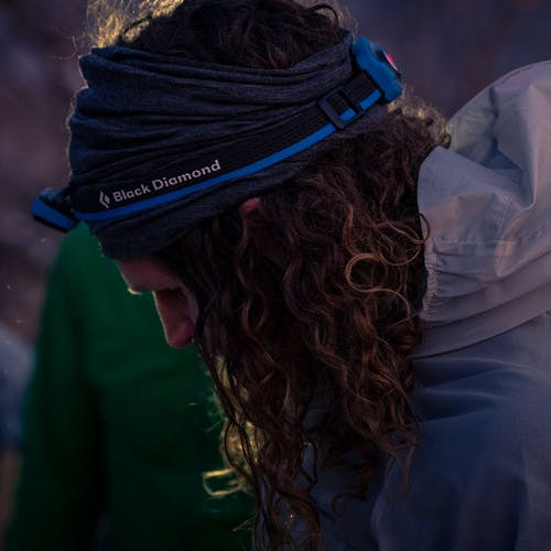 Joe Grant prepping for a sunrise run wearing a headlamp