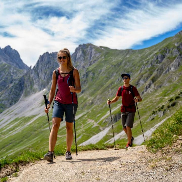 Photograph by Noah Wallace of a woman and man hiking outside