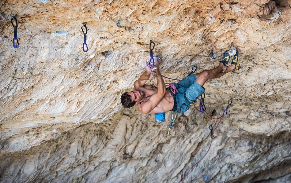Photo of Joey Kinder rock climbing.