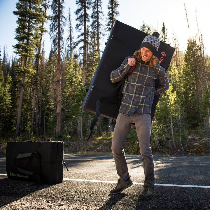 Photograph by Andy Earl of a man walking with a crash pad | Men's Shirts