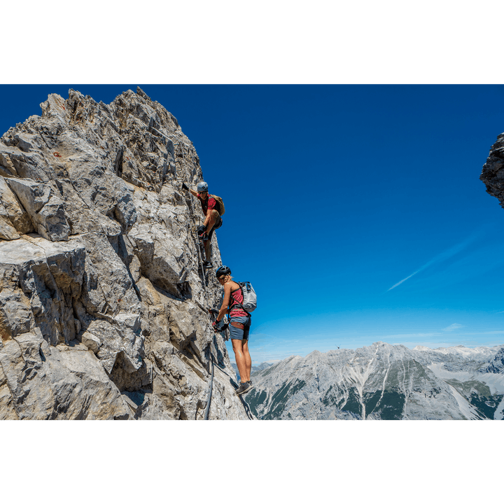 two people at the top of a via ferrata