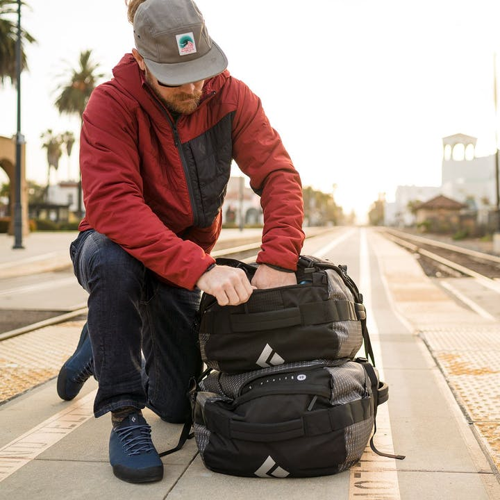 Photograph by Christian Adam of man and luggage at a train station