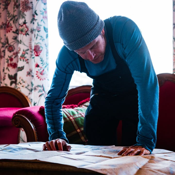 Photograph by Mattias Fredriksson of a man studying a map