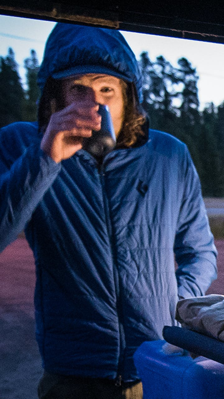 Joe Grant drinking coffee before the beginning of his run