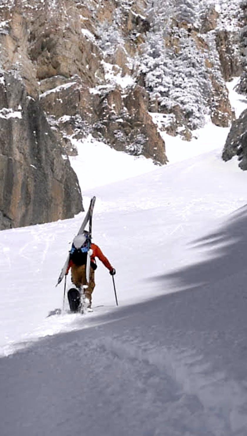 Skier trekking up mountain