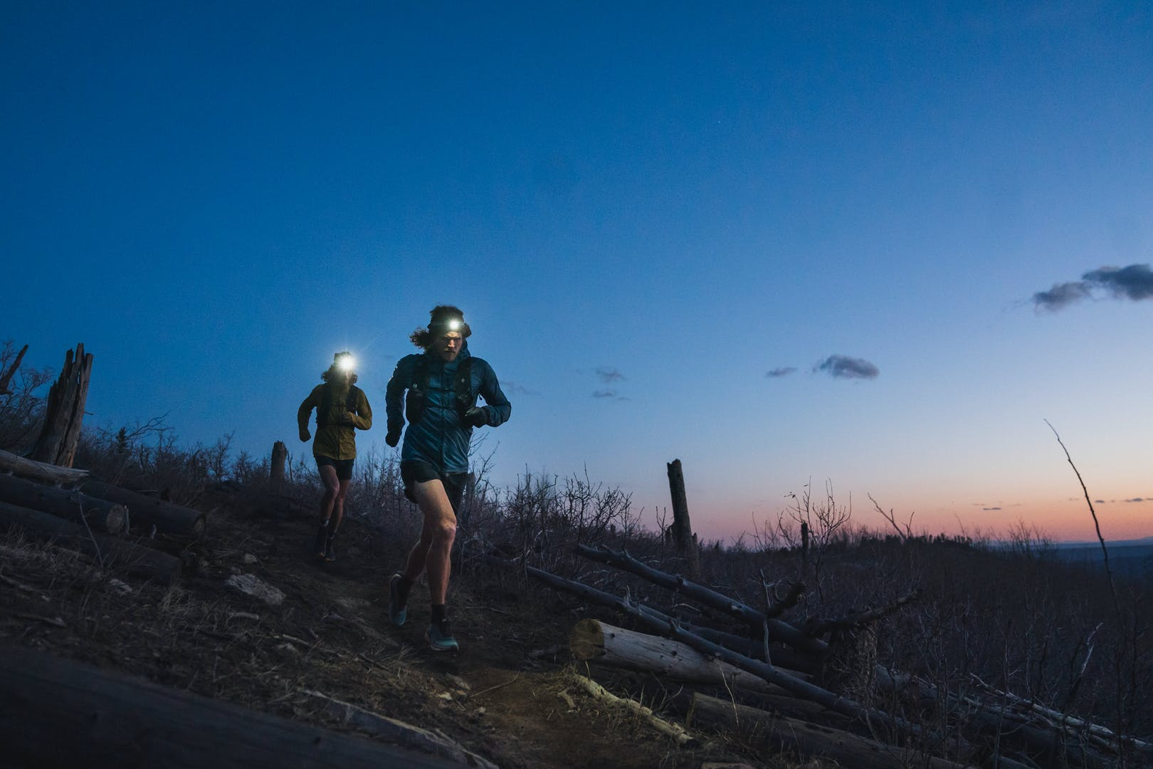 BD athletes Kyle Richardson and Joe Grant running at sunset