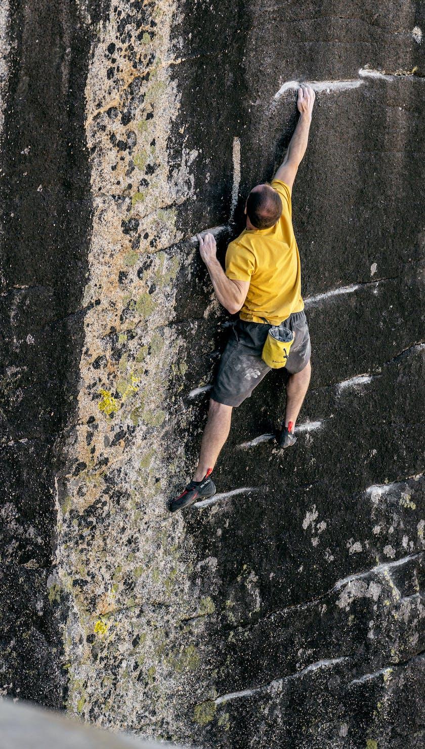 Carlo Traversi climbing a route