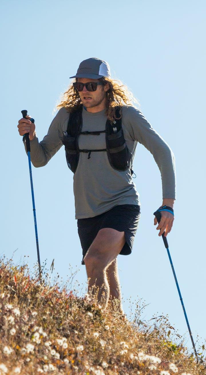 BD Athlete Joe Grant running up a hillside