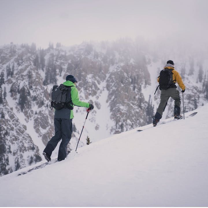 Black Diamond Athlete Bjorn Leines and JMOSends backcountry skiing up a snowy mountain.