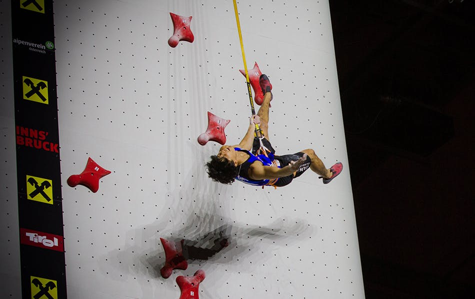 Climber coming down from speed climb finish