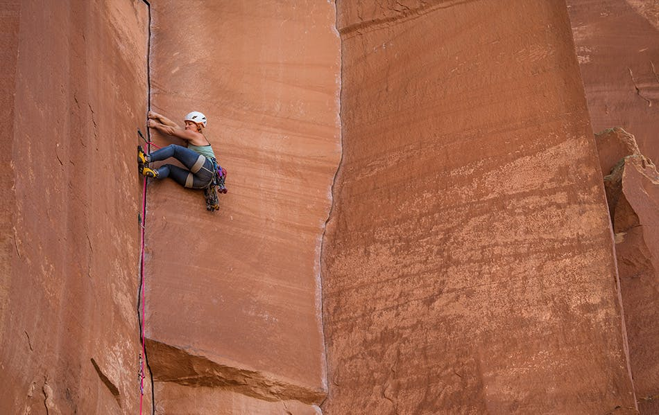 Photograph by Andy Earl of Hazel Findlay climbing outdoors in Southern Utah