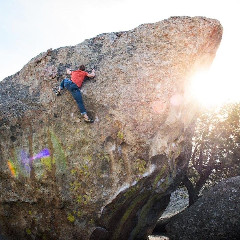 climber on a boulder