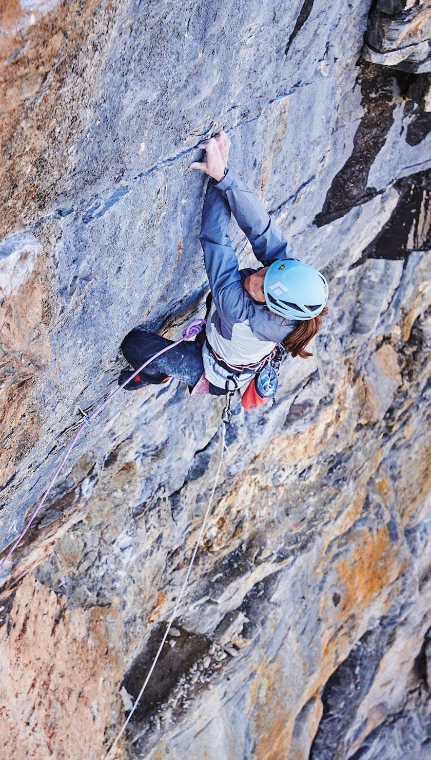 Babsi Zangerl rock climbing with a vapor helmet