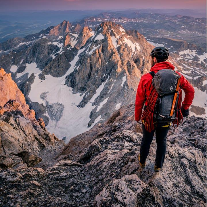 Alpine climber on a summit with Black Diamond equipment.